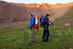 Two backpackers in mountains Royalty Free Stock Image