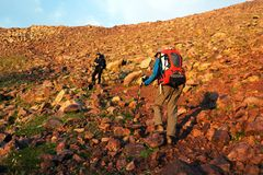 Two backpackers in mountains Royalty Free Stock Photo