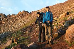 Two backpackers in mountains Royalty Free Stock Photos