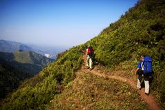 Two backpackers in mountains Stock Photo