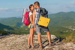 Two backpackers in mountains. Royalty Free Stock Photos