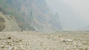 Backpackers with guide walk on the Manaslu mountain circuit trek in Nepal.