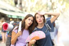 Two backpackers suffering heat stroke on vacation royalty free stock photos