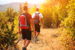 Two backpackers in the summer mountain Stock Photos
