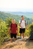 Two backpackers in the summer mountain Royalty Free Stock Photo