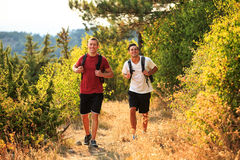 Two backpackers in the summer mountain Royalty Free Stock Images