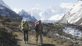 Two backpackers on the trekking Larke Pass in Nepal. Manaslu area. Two backpackers on the trekking Larke Pass in Nepal. Manaslu area stock video