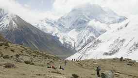 Two backpackers on the trekking Larke Pass in Nepal. Manaslu area. Two backpackers on the trekking Larke Pass in Nepal. Manaslu area stock footage