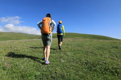 Two backpacking women friends hiking Stock Image