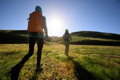 Two backpacking women hiking Royalty Free Stock Images