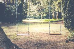 Two Backyard Swings Royalty Free Stock Photos