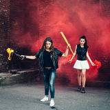 Two Bad fan girls with Molotov cocktail and red smoke bomb Stock Image