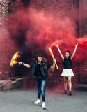 Two Bad girls with Molotov cocktail and red smoke bomb Royalty Free Stock Images