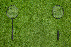 Two badminton rackets lying on the grass Stock Photos