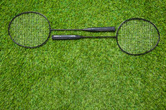 Two badminton rackets lying togeather on the grass Stock Photography