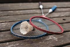 two badminton rackets on the old wooden table Royalty Free Stock Images