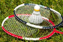 Two badminton rackets and shuttlecock closeup Stock Images