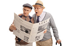 Two baffled senior men reading the news Stock Photo