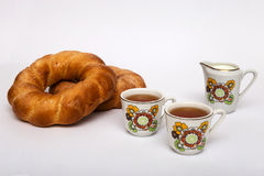 Two bagels and cups with tea Stock Image