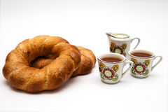 Two bagels and cups with tea Stock Images