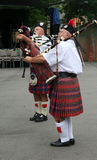 Two Bagpipers Stock Images