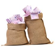 Two bags with many euro banknotes Stock Photos