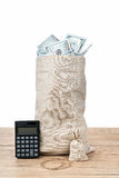 Two bags with money and calculator Royalty Free Stock Images