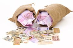Two bags with much money. Isolated Stock Photos