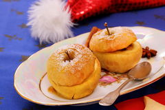 Two baked apples as Christmas Dessert Royalty Free Stock Photos