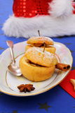 Two baked apples as Christmas dessert Royalty Free Stock Images