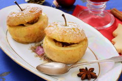 Two baked apples as Christmas dessert Royalty Free Stock Photo