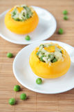 Two baked turnip stuffed with green peas Stock Photos