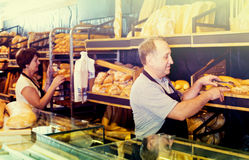 Two bakers at the counter at bakery Royalty Free Stock Photos