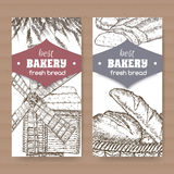 Two bakery label templates with wooden windmill, wheat and bread on white Royalty Free Stock Photo