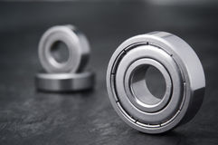 Two ball bearings monochrome. Product recording a single focus in the foreground of depicted bearing bearing two further consecutive positioned formed blur in royalty free stock images