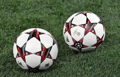 Two ball of Champions League in the field Royalty Free Stock Photo