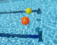 Two ball floating on the swimming pool Royalty Free Stock Image