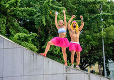 Two ballerinas, male and female, in bright pink tutu skirts standing at the Memorial Getulio Vargas Stock Image
