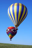 Two balloons. A vertical shot of a pair of hot air balloons in flight Royalty Free Stock Photo