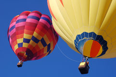 Two balloons. A pair of hot air balloons in flight stock photos