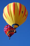 Two balloons. A pair of hot air balloons in flight Royalty Free Stock Photo