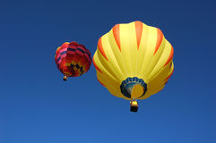 Two balloons. A pair of hot air balloons in flight stock image