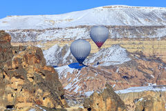 Two balloons on a background of mountains of Capadocia. Turkey. Two flying balloons on a background of mountains of Capadocia. Turkey Royalty Free Stock Photos
