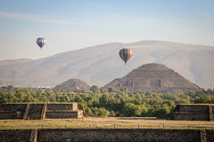 Balloons over Teotihuacan. Two Balloons flying over the Teotihuacan in front of the Pyramid of the Sun and Pyramid of the Moon stock photos