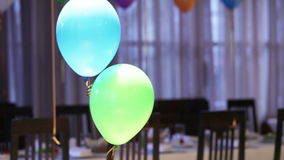 Two balloons. Helium-filled balloons to children's birthday party stock video