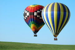 Two balloons horizontal. A horizontal shot of a pair of hot air balloons in flight Stock Image