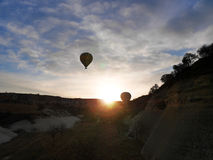 Two balloons taking off at sunrise Royalty Free Stock Photography