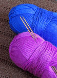 Two balloons of yarn with knitting needles Stock Photo