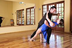 Two ballroom dancers practicing in their studio Royalty Free Stock Image