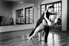 Two ballroom dancers practicing in their studio Royalty Free Stock Images